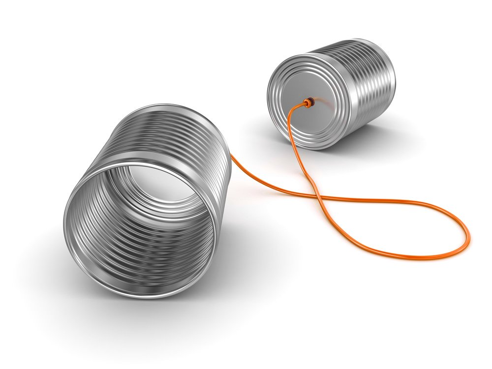 Tin can telephones joined by bright orang string